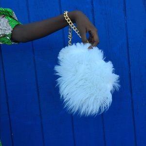 Mini round furr purse.